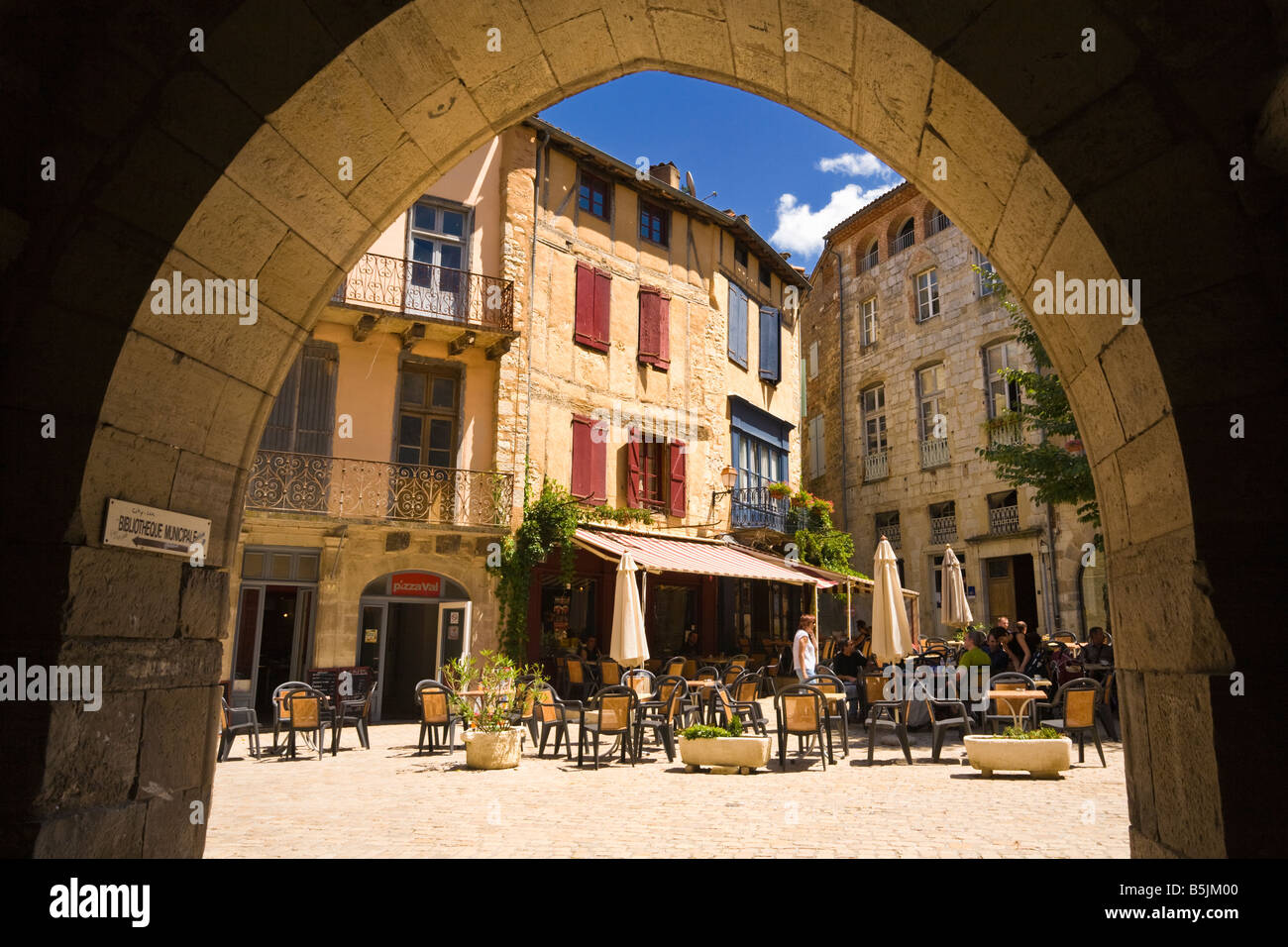 Pavement cafe restaurants in the medieval town square St Antonin Noble Val in Tarn et Garonne, France, Europe - Stock Image
