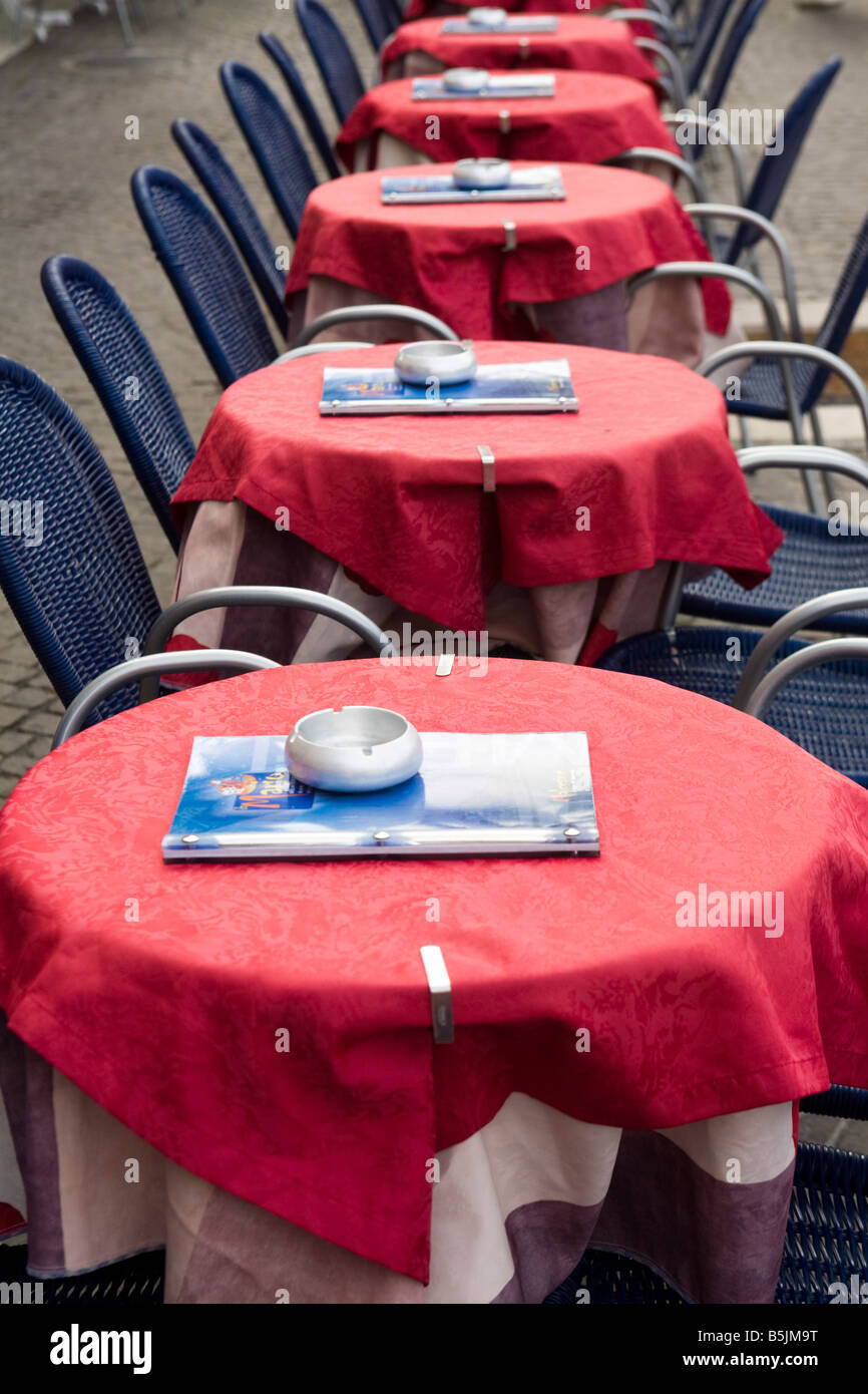 Outside bar with red cloths tables and blue chairs at Malcesine Harbour, Veneto, Italy - Stock Image