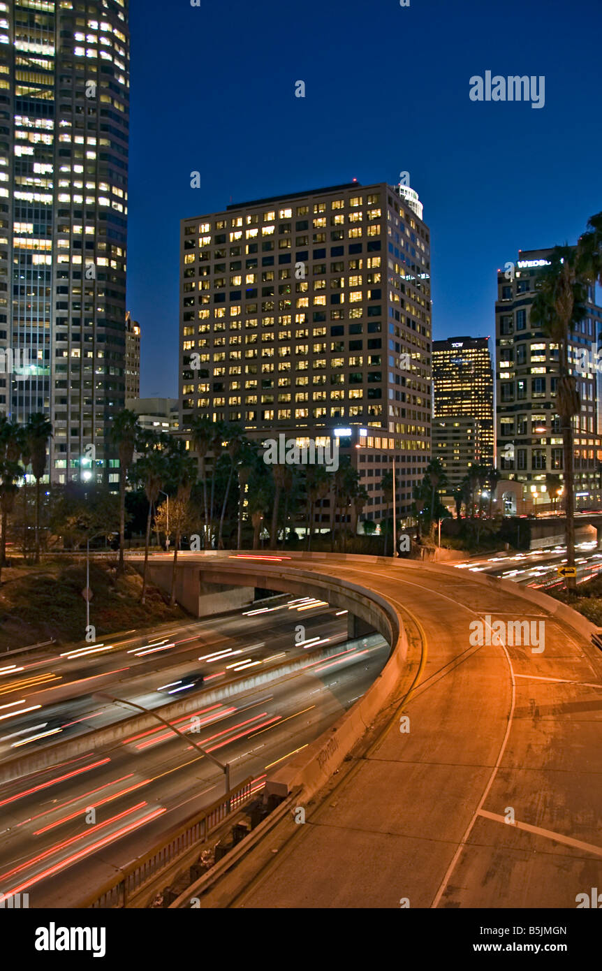US 101, Harbor Freeway LA skyline, Dusk Los Angeles, California, USA Traffic moving CA economic, cultural, entertainment - Stock Image