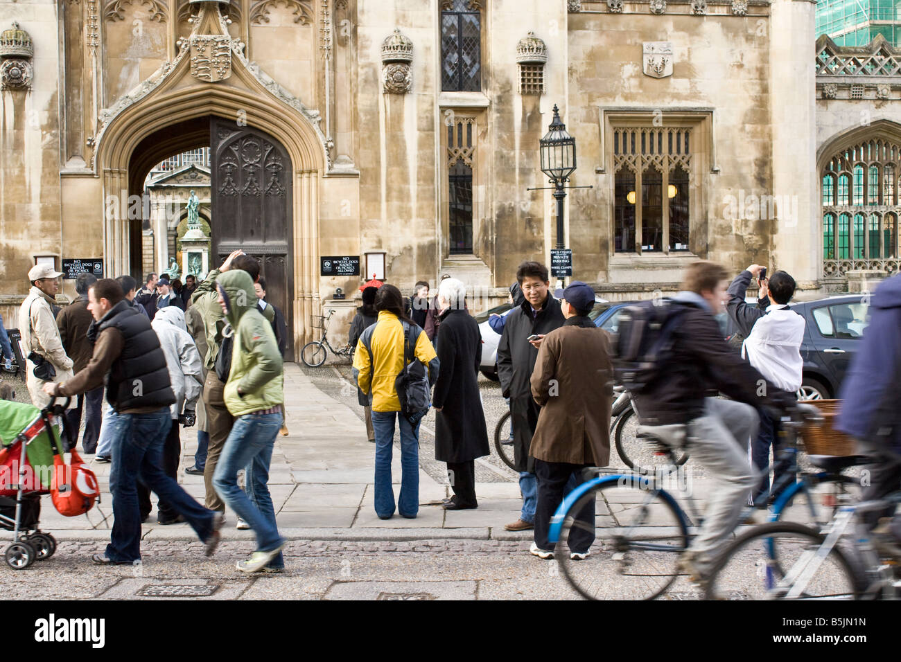 Tourists visiting King's College in Cambridge UK - Stock Image