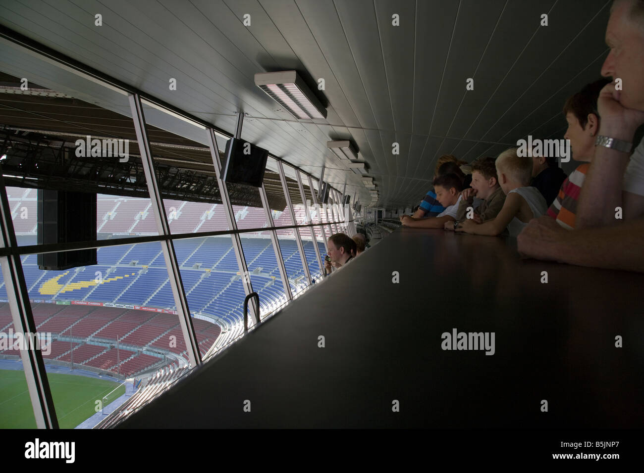 Barcelona football fans looking out over the pitch from the commentators gantry, CAMP NOU FC BARCELONA FOOTBALL - Stock Image