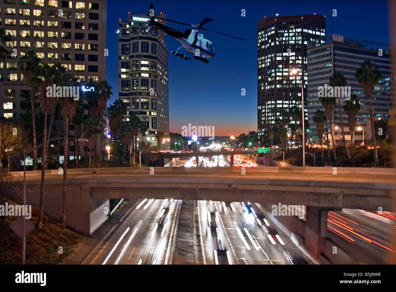 US 101, Harbor Freeway LA skyline, Dusk Los Angeles, California, USA Traffic moving CA economic cultural, Helicopter - Stock Image