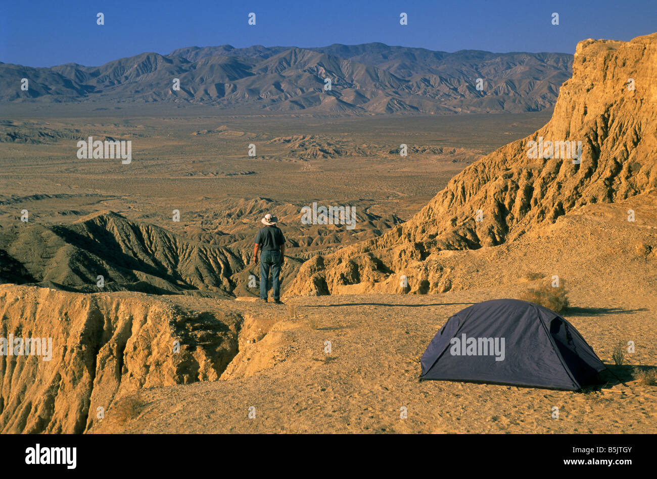 Hiker camping at Fonts Point in Borrego Badlands at sunrise at Anza Borrego State Desert Park California USA - Stock Image