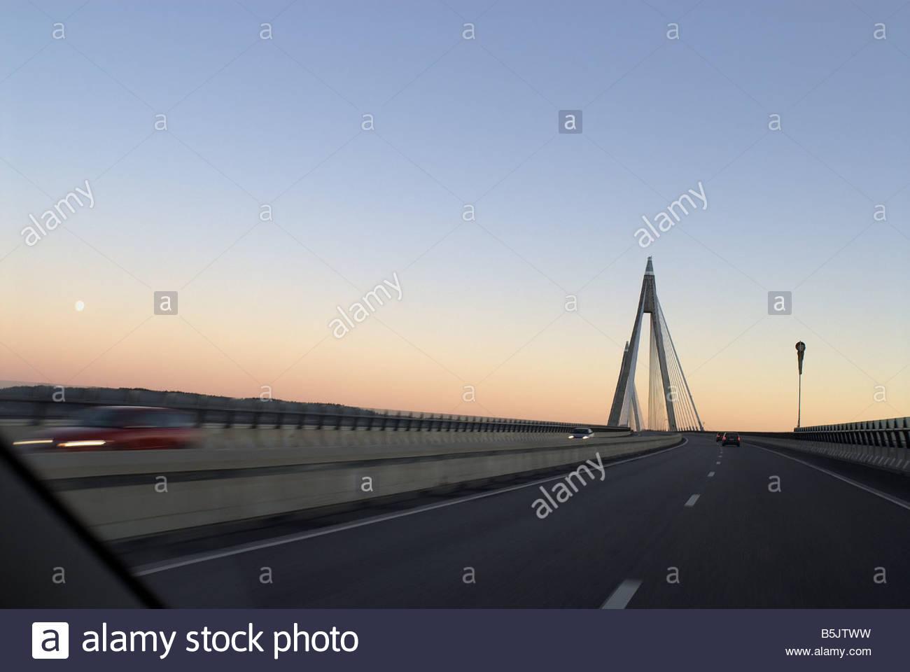 Uddevalla cable stayed bridge - the worlds largest on highway E6, southwest Sweden. Sunset, photographed through - Stock Image