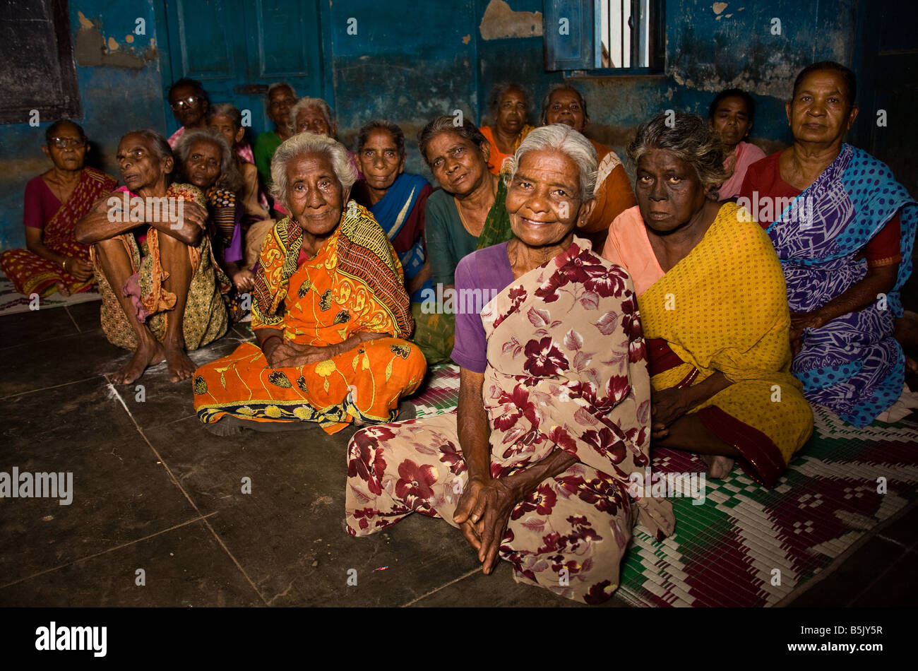 Chennai Help Aged India Recipients wait for meals-on-wheels in Nagar district Chennai India - Stock Image
