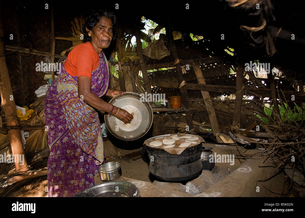 Rasamball makes and sells idly in her bamboo shack at HAI Kandakadu village TamilNadu - Stock Image