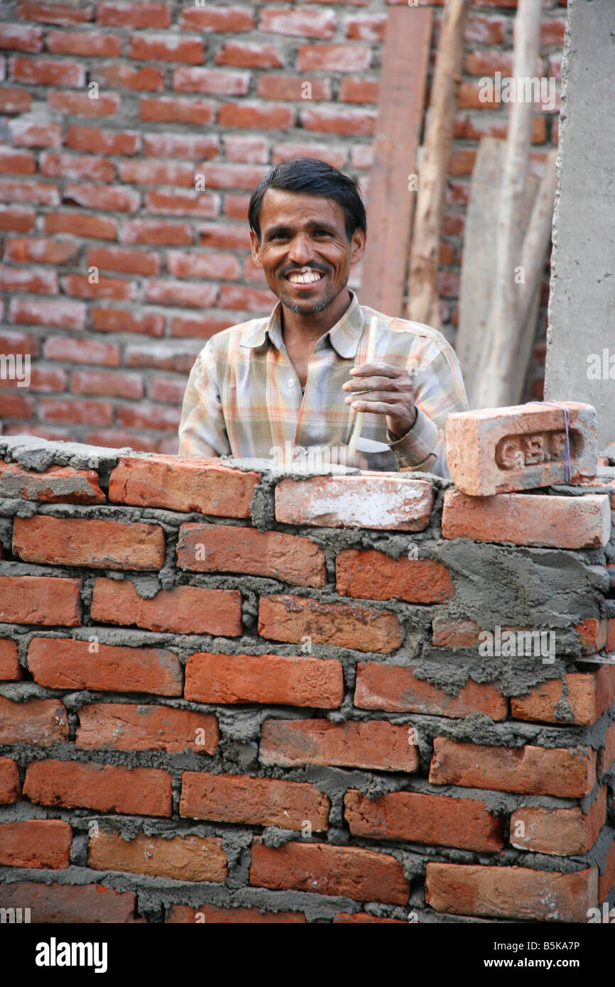 Construction worker in residential part of old delhi india ...