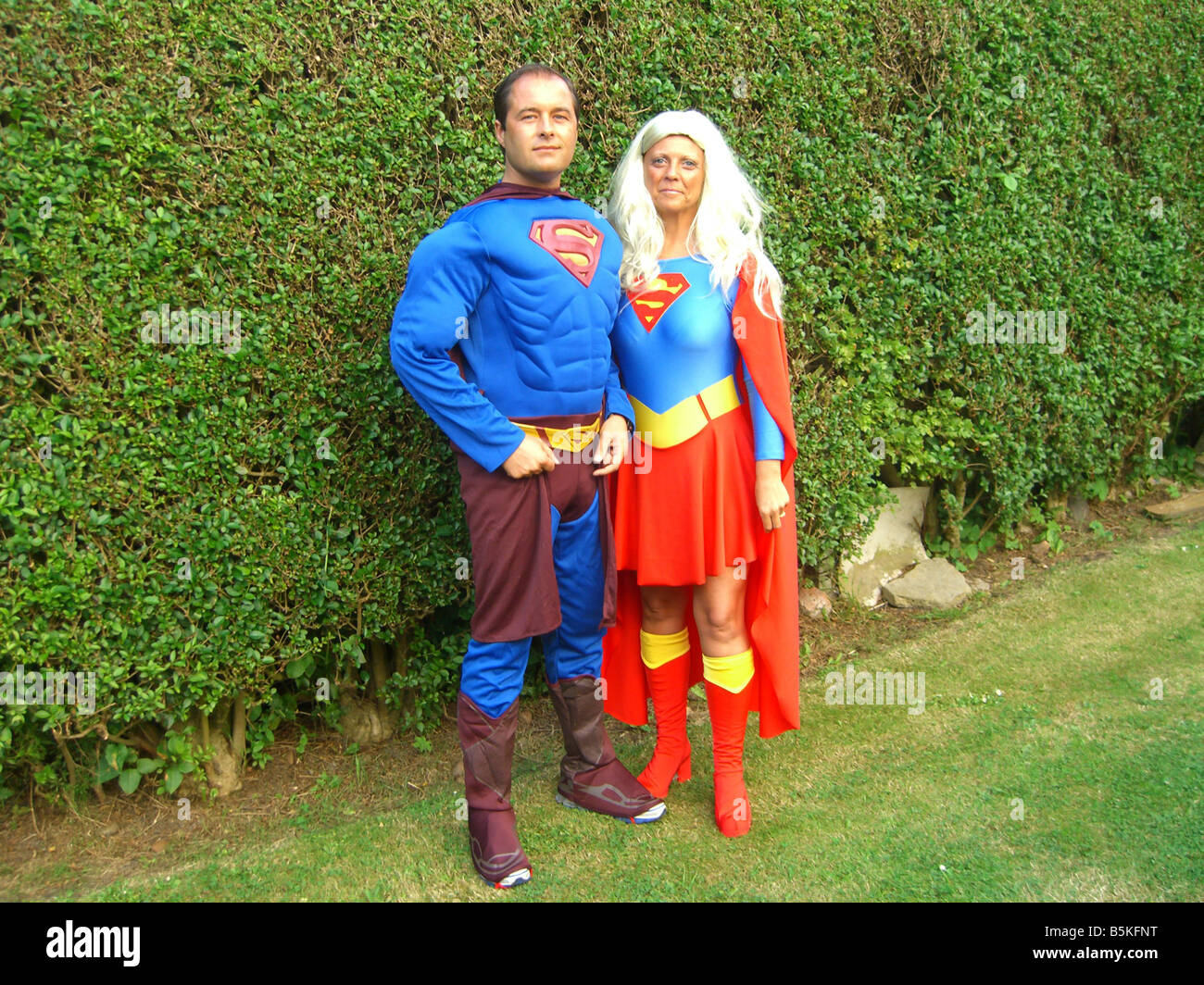 Superman and superwoman ready to attend a fancy dress party.  sc 1 st  Alamy & Superman and superwoman ready to attend a fancy dress party Stock ...