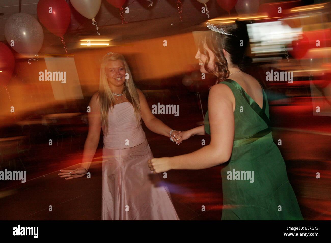 Teenage girls dancing at their High School Prom at Southampton Football Club, England - Stock Image