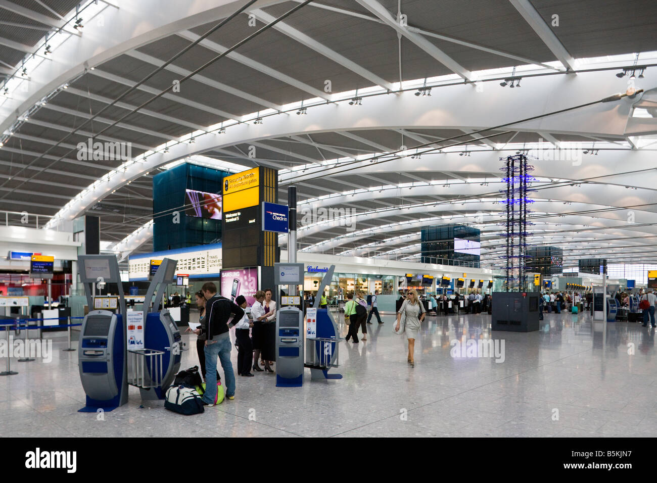 self check in, departure level, Terminal 5, Heathrow, London, England - Stock Image