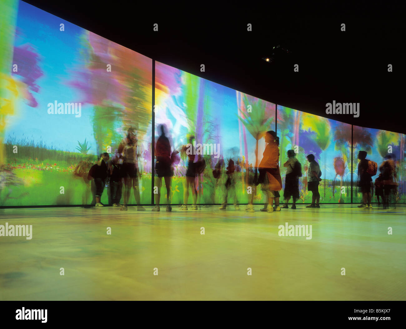 People watching temporary installation at the Water Expo (long exposure), Zaragoza, Spain. - Stock Image