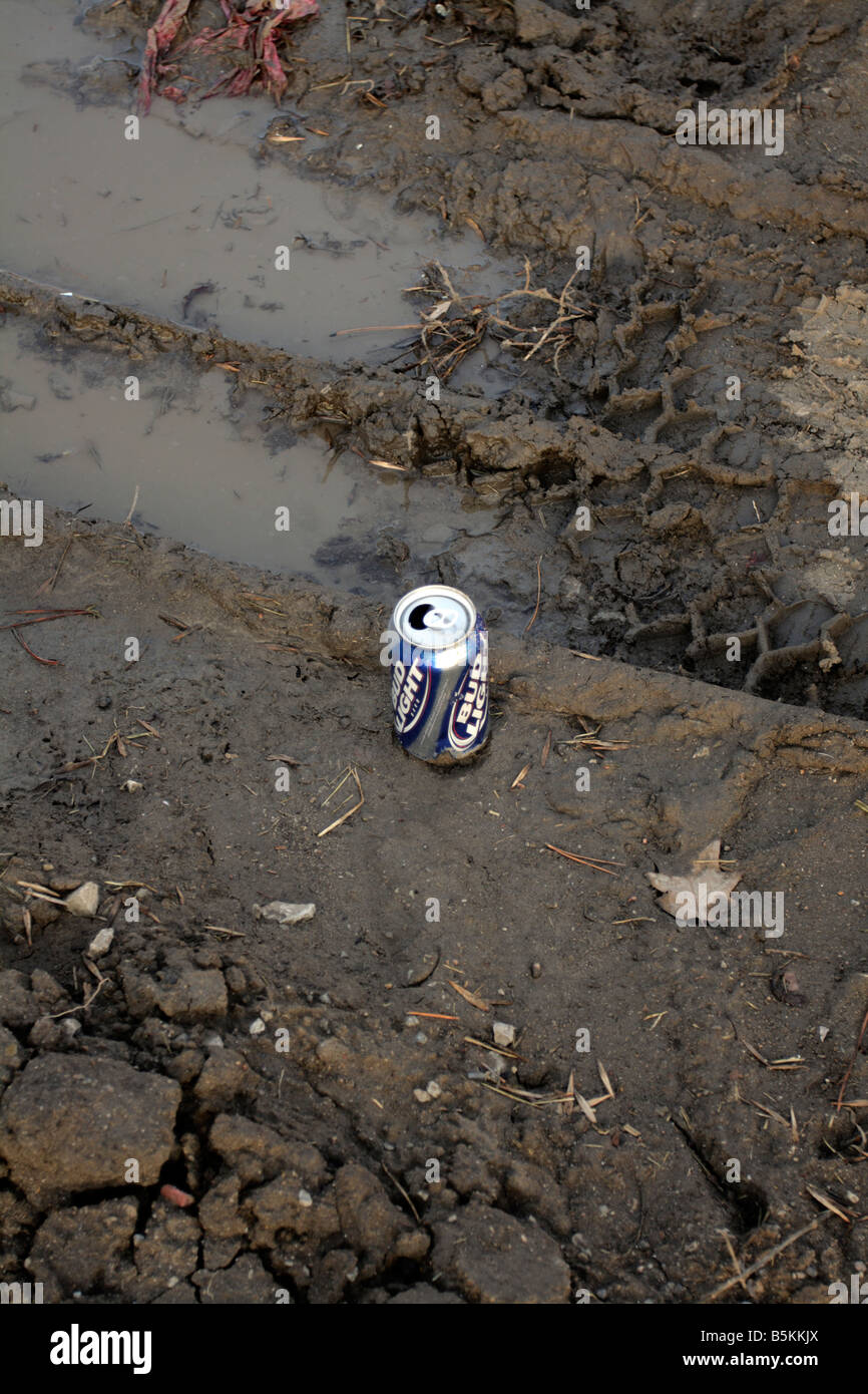 Bud Light Beer Can Stuck In Mud Next To Ruts.   Stock Image