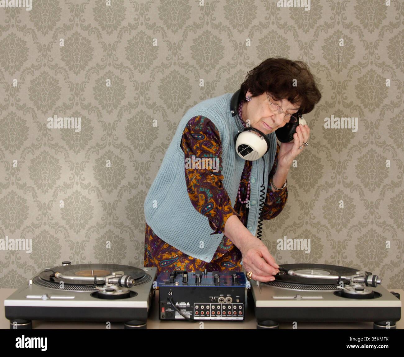 a very funky elderly granny dj go lady Stock Photo: 20716855