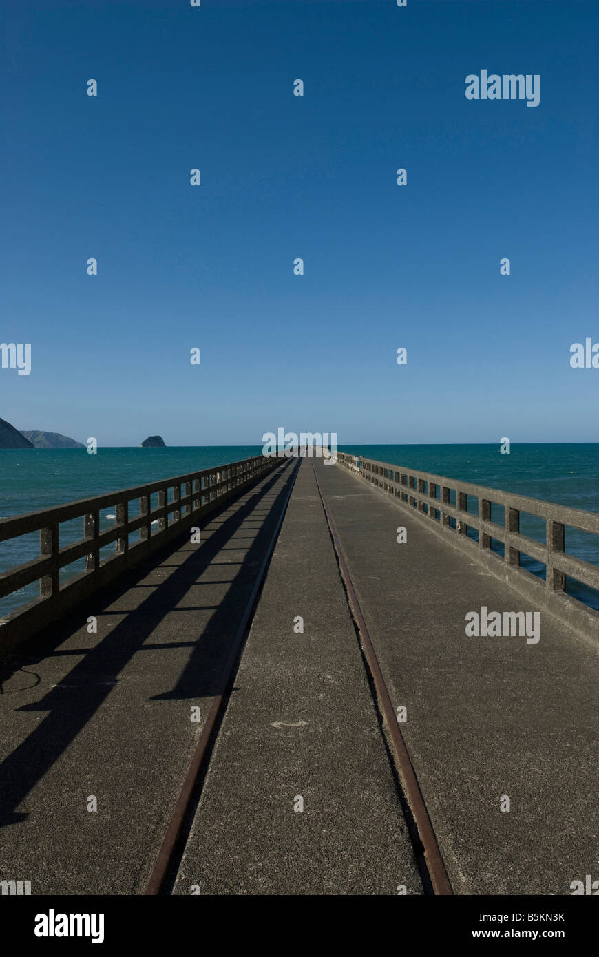 Tolaga Bay wharf - 660 meters long  or 2165 ft -  in New-Zealand. The longest pier in the southern hemisphere. Stock Photo