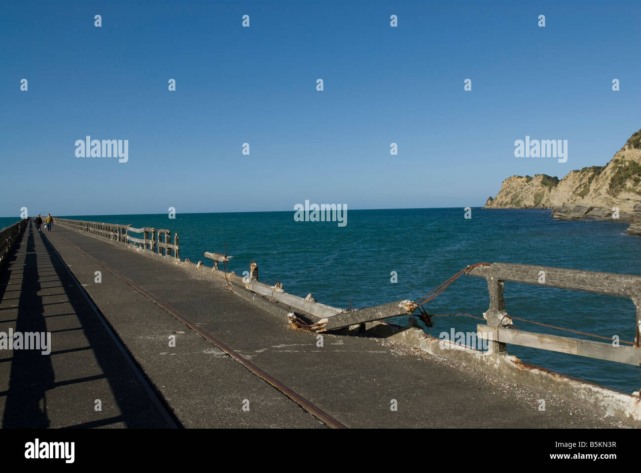 Tolaga Bay wharf - 660 meters long  or 2165 ft -  in New-Zealand. - Stock Image