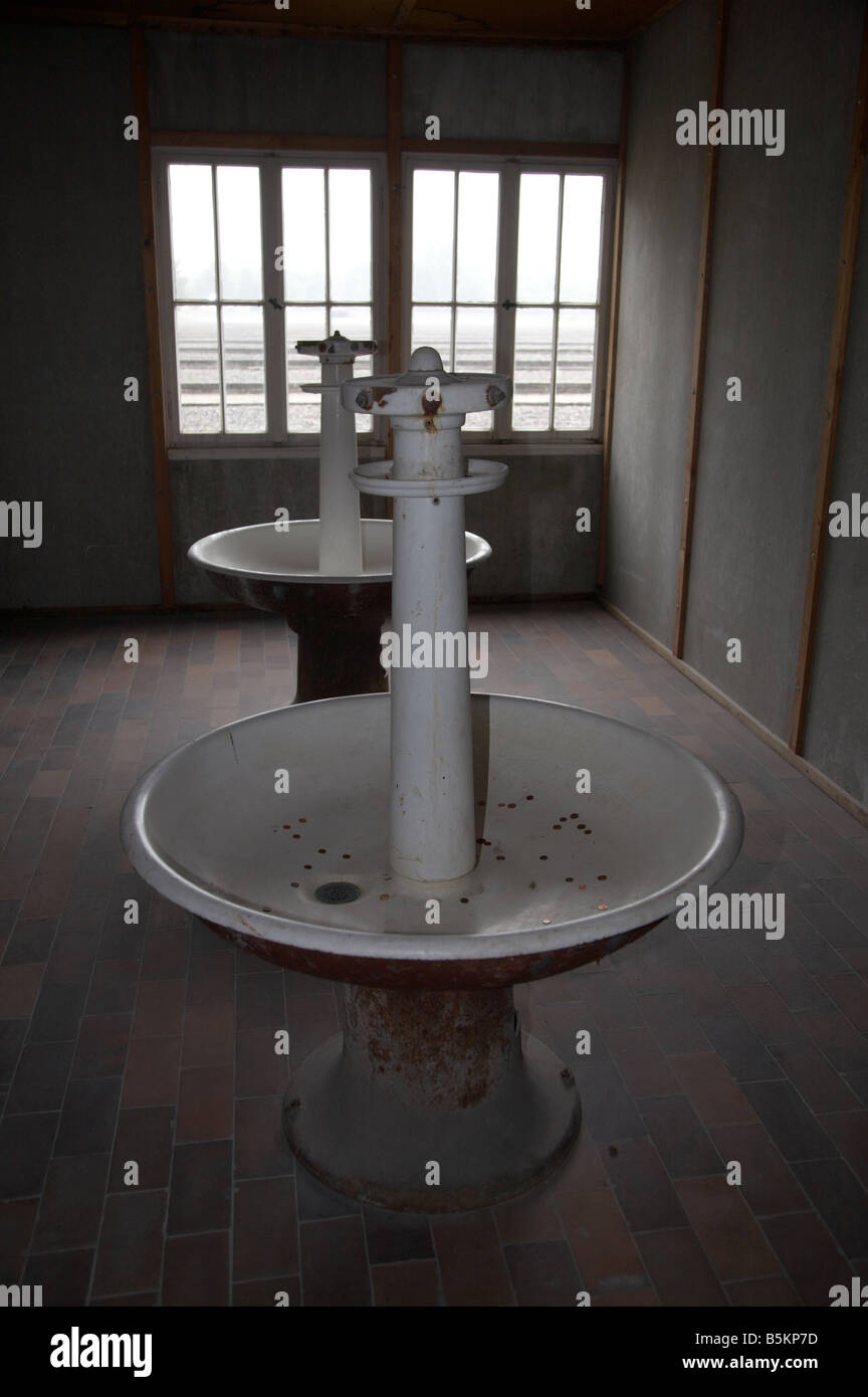communal wash basins for prisoners at dachau second world war concentration camp in germany - Stock Image