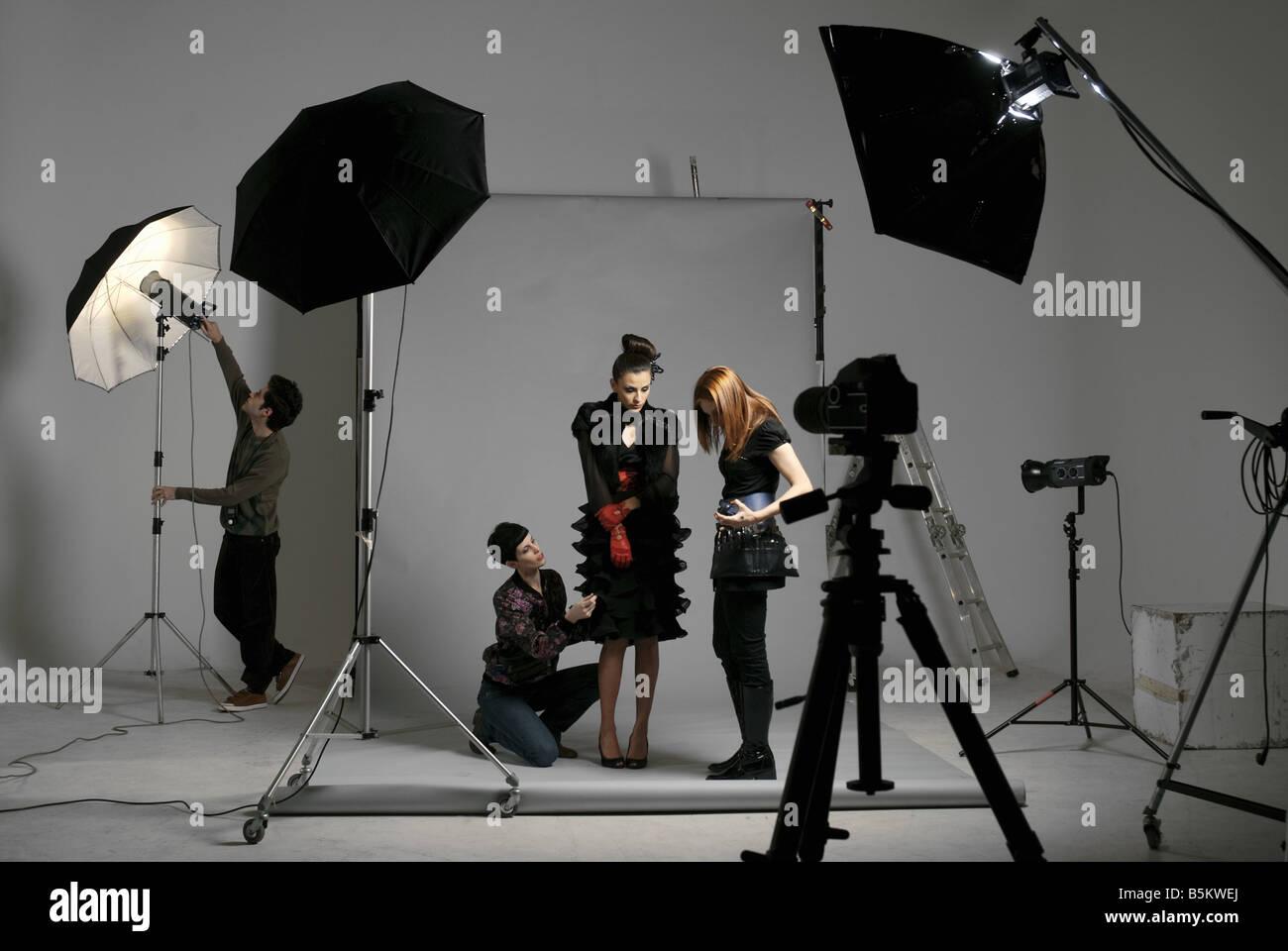 Professionals on fashion shooting set - Stock Image