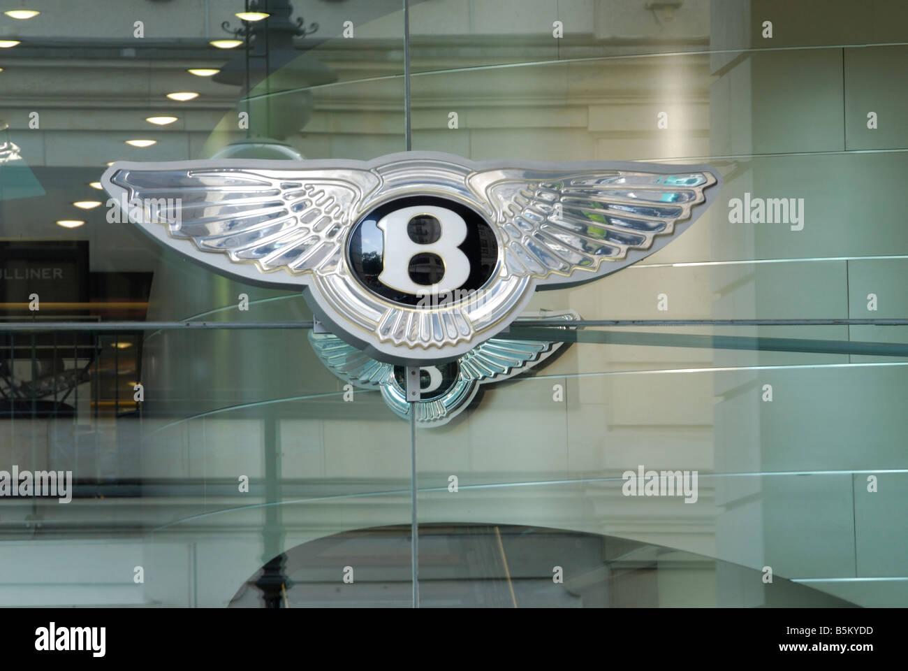 Bentley emblem in glass window of Bentley show room Berlin Germany - Stock Image