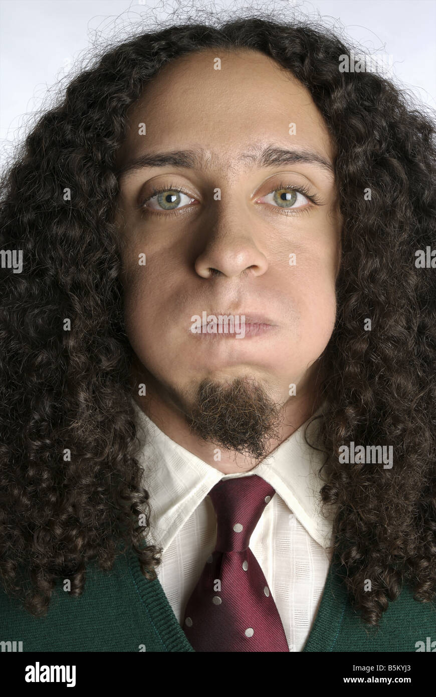 Shaggy haired man in formal attire. - Stock Image