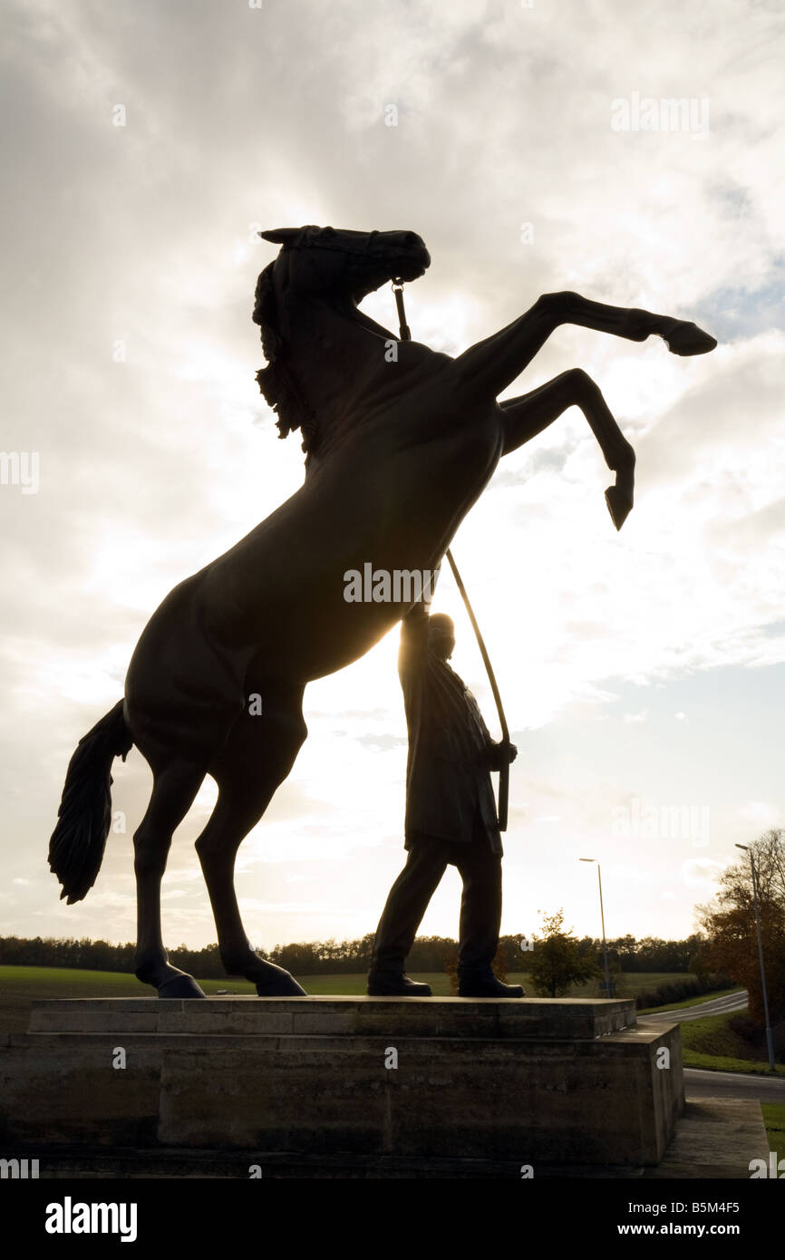 The rearing horse statue at the entrance to Newmarket, Suffolk, UK - Stock Image