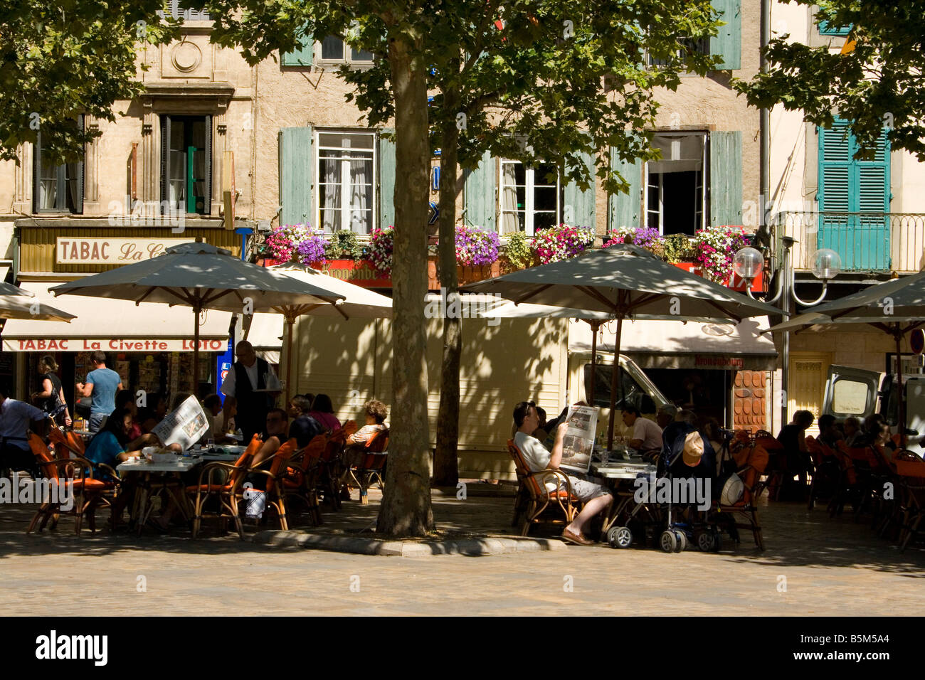 cafe bar restaurant place square town market parasol relax holiday de-stress - Stock Image