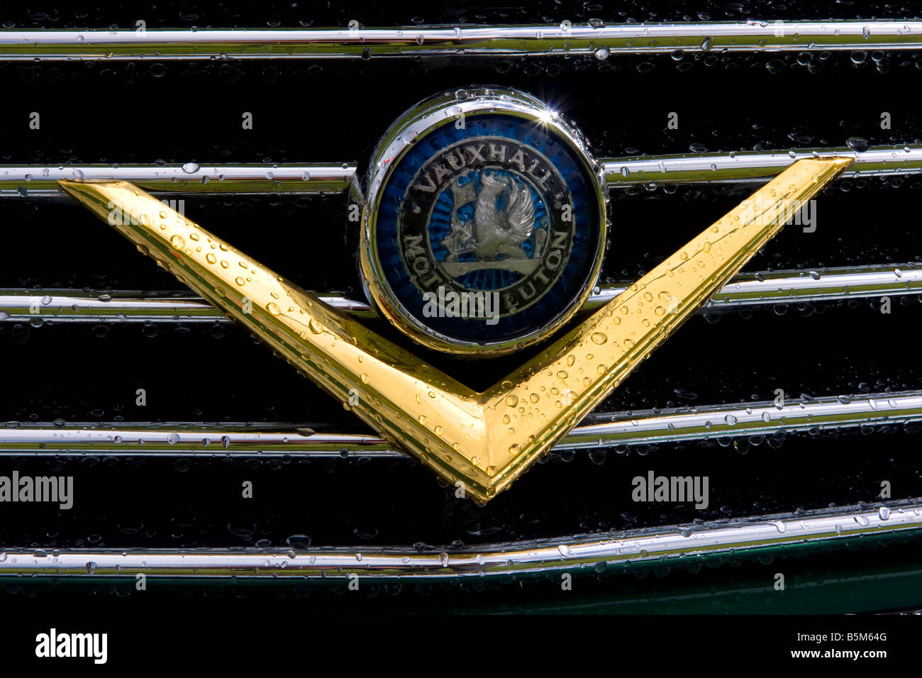 vauxhall motors luton car badge and grille with rain drops and chrome - Stock Image