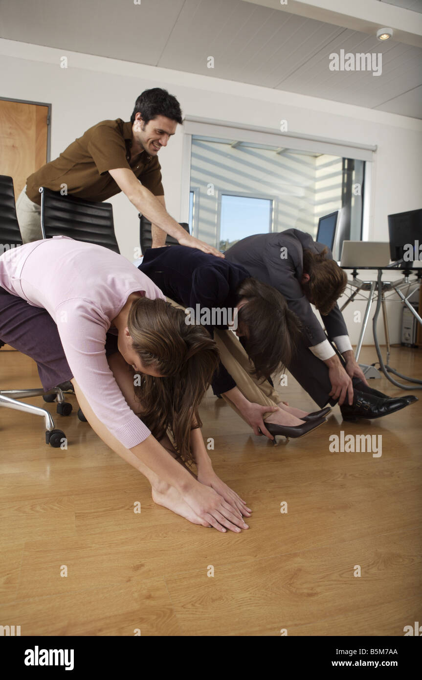 Yoga session at business meeting - Stock Image