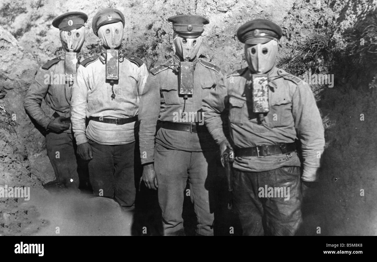 Russian officers with gasmasks WWI 1916 History World War I Gas war Russian officers with gasmasks in a trench Photo - Stock Image