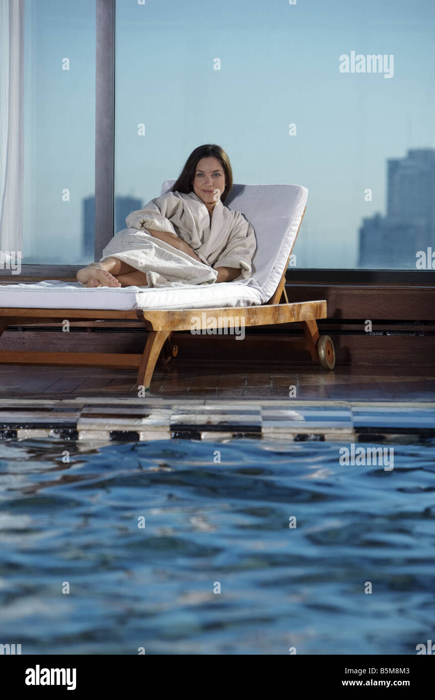 One woman lounging at the pool. Stock Photo