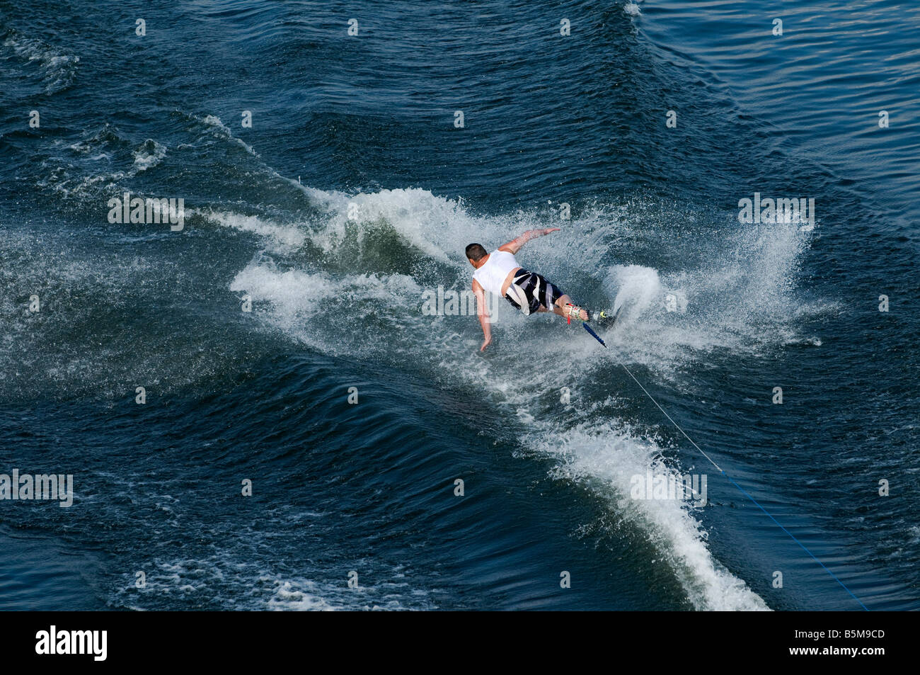 Waterskier in action at waterski and wakeboard competition in Putrajaya, Malaysia. - Stock Image