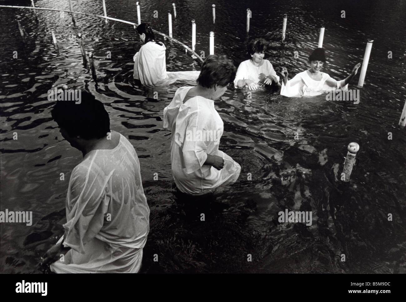 Pilgrims being baptised in the River Jordan, Kibbutz Kinneret, Israel 1999 - Stock Image