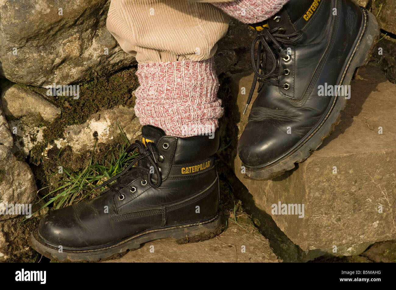 052da8a7c7b Man wearing walking boots England UK United Kingdom GB Great Britain ...