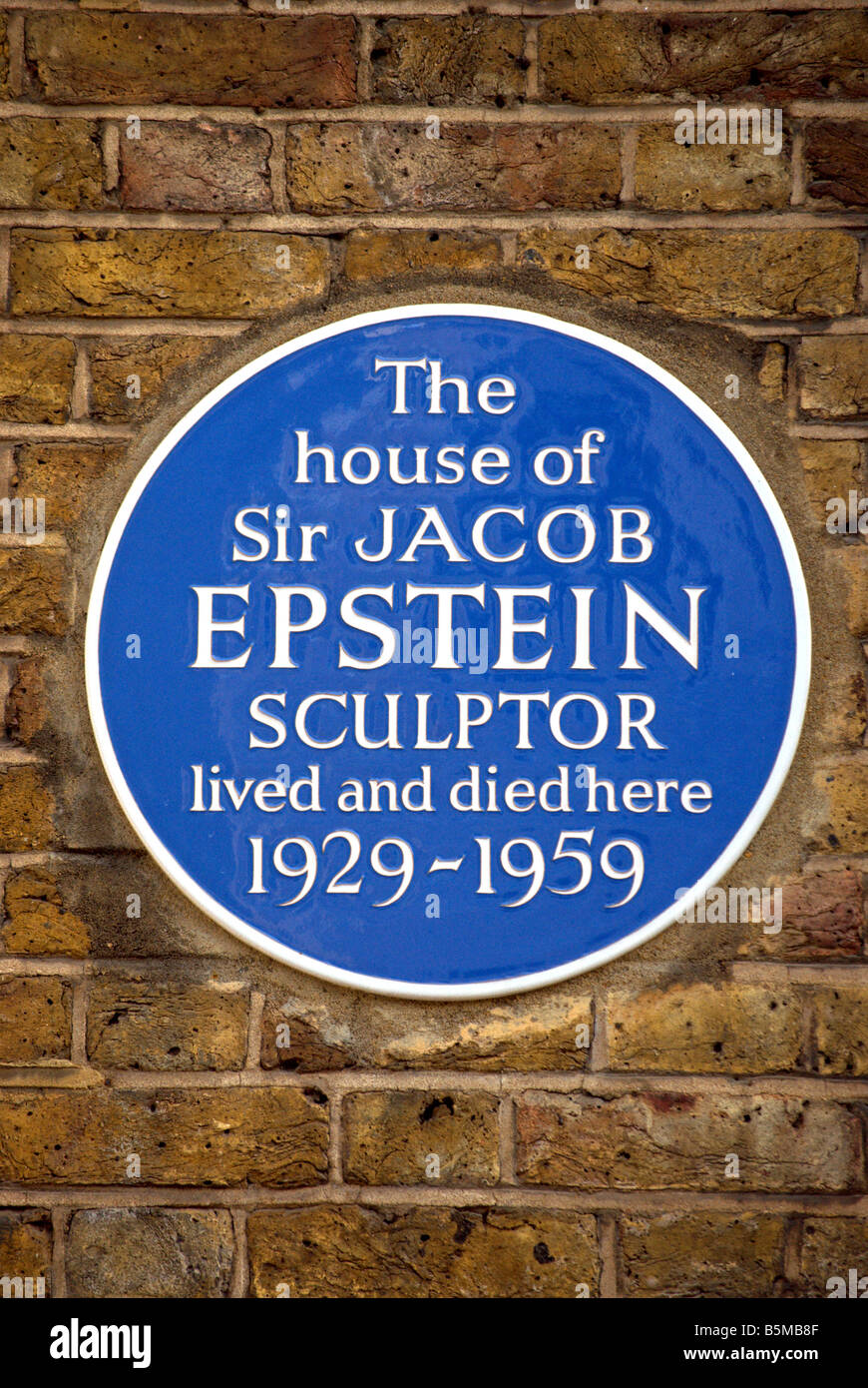 blue plaque marking a house where sculptor sir jacob epstein lived and died, in kensington, london, england - Stock Image