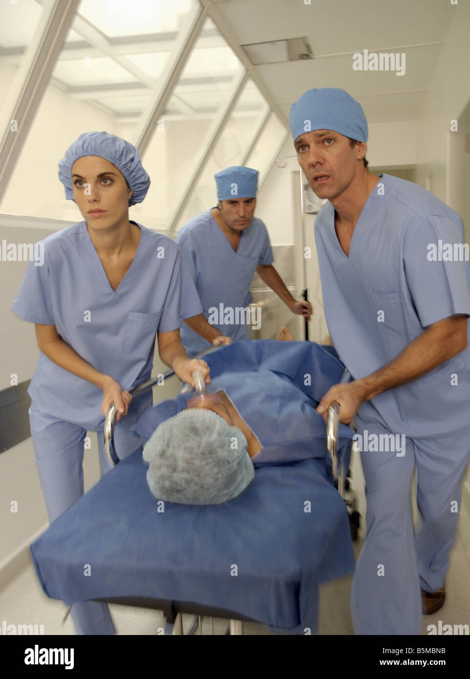 Doctors in an urgency rush Stock Photo
