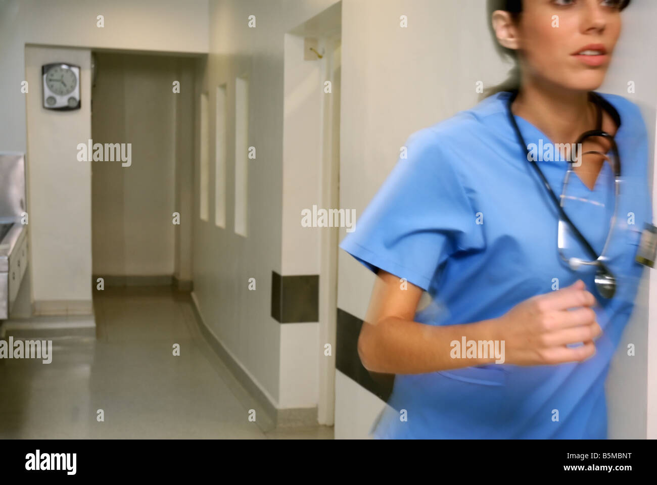 Female doctor in an emergency rush Stock Photo