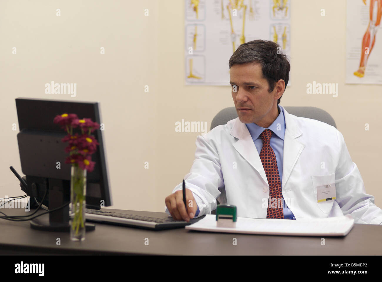 Doctor attending at office Stock Photo