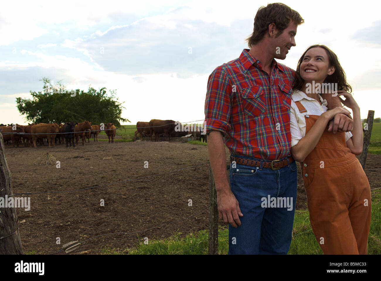A young couple on a ranch - Stock Image
