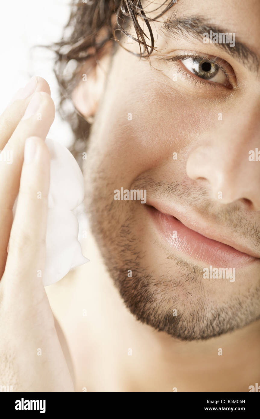 A man about to apply shaving cream on his face - Stock Image