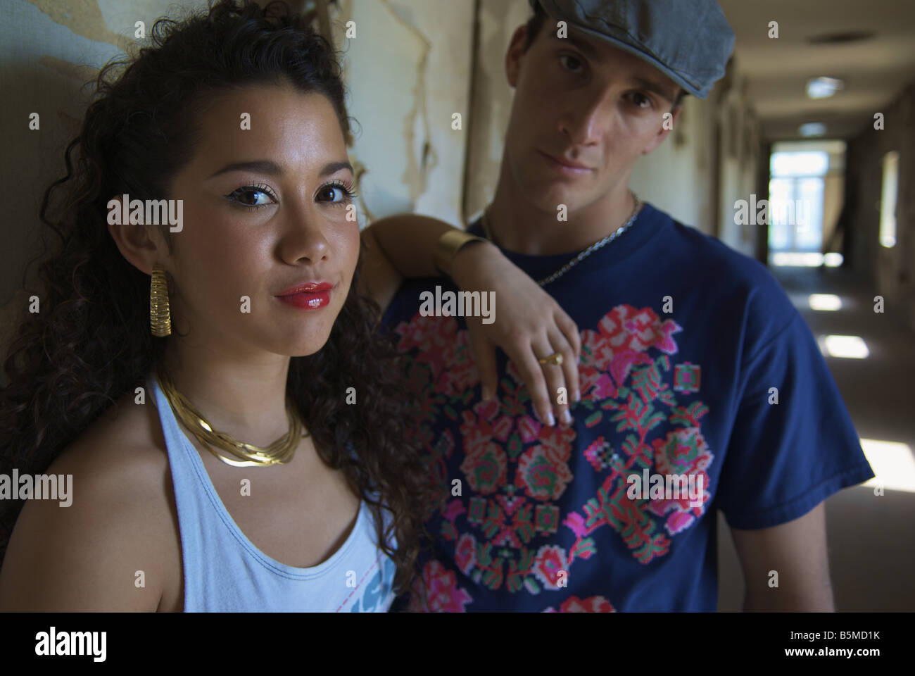 A young man and teenage girl in a hallway - Stock Image