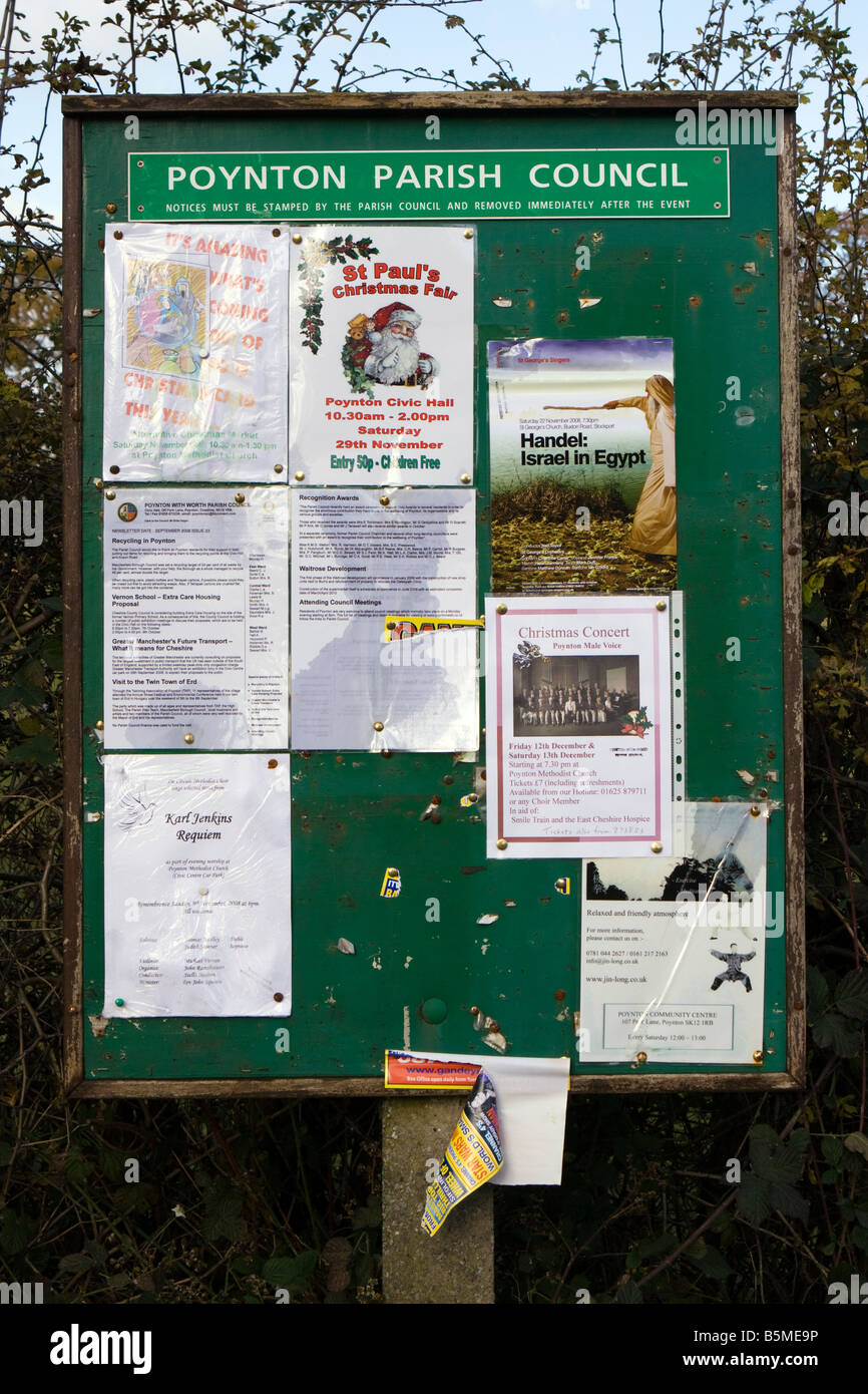 UK Cheshire Poynton Parish Council notice board carrying community announcements and posters - Stock Image