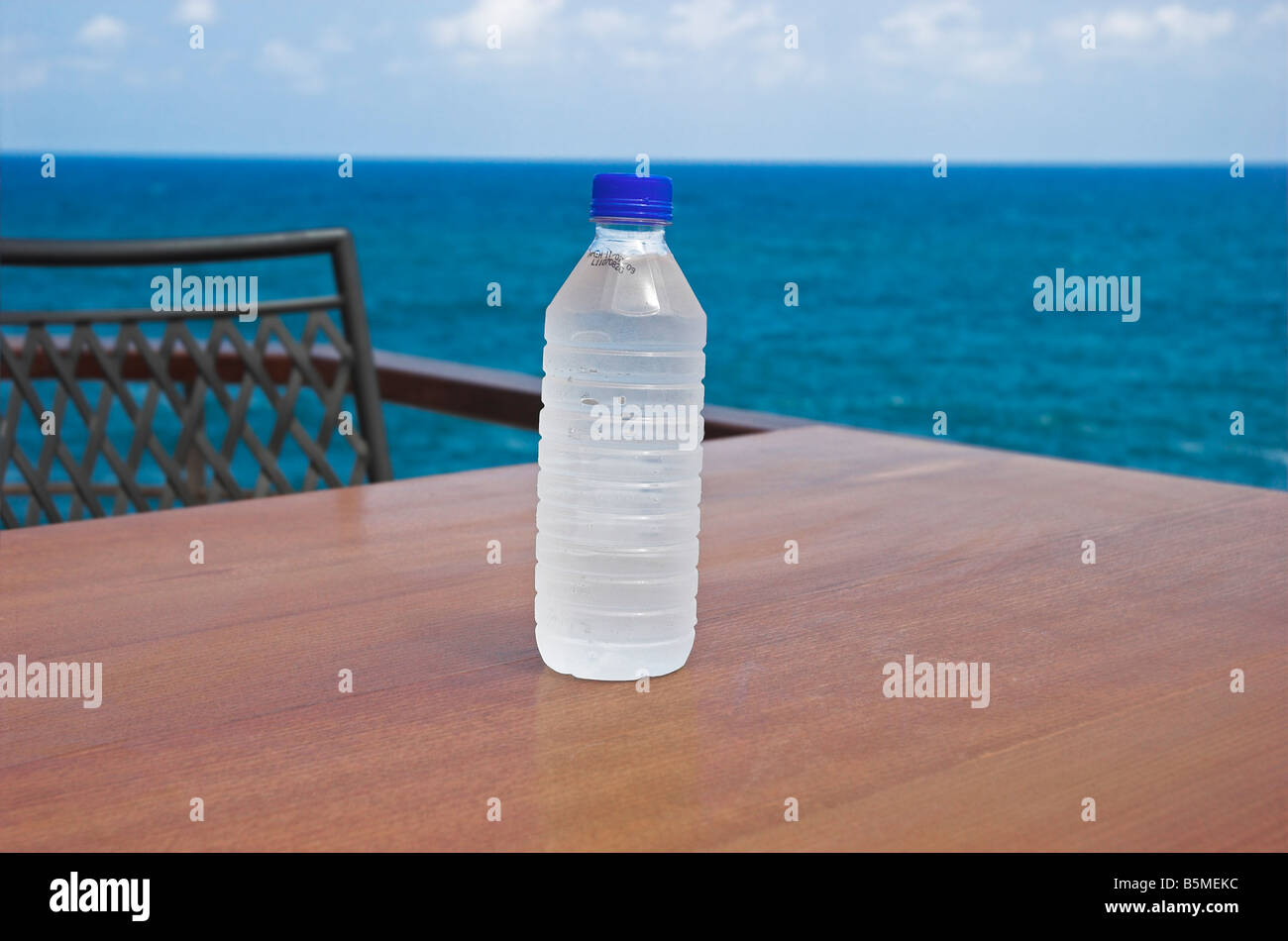 Bottle of water on table - Stock Image