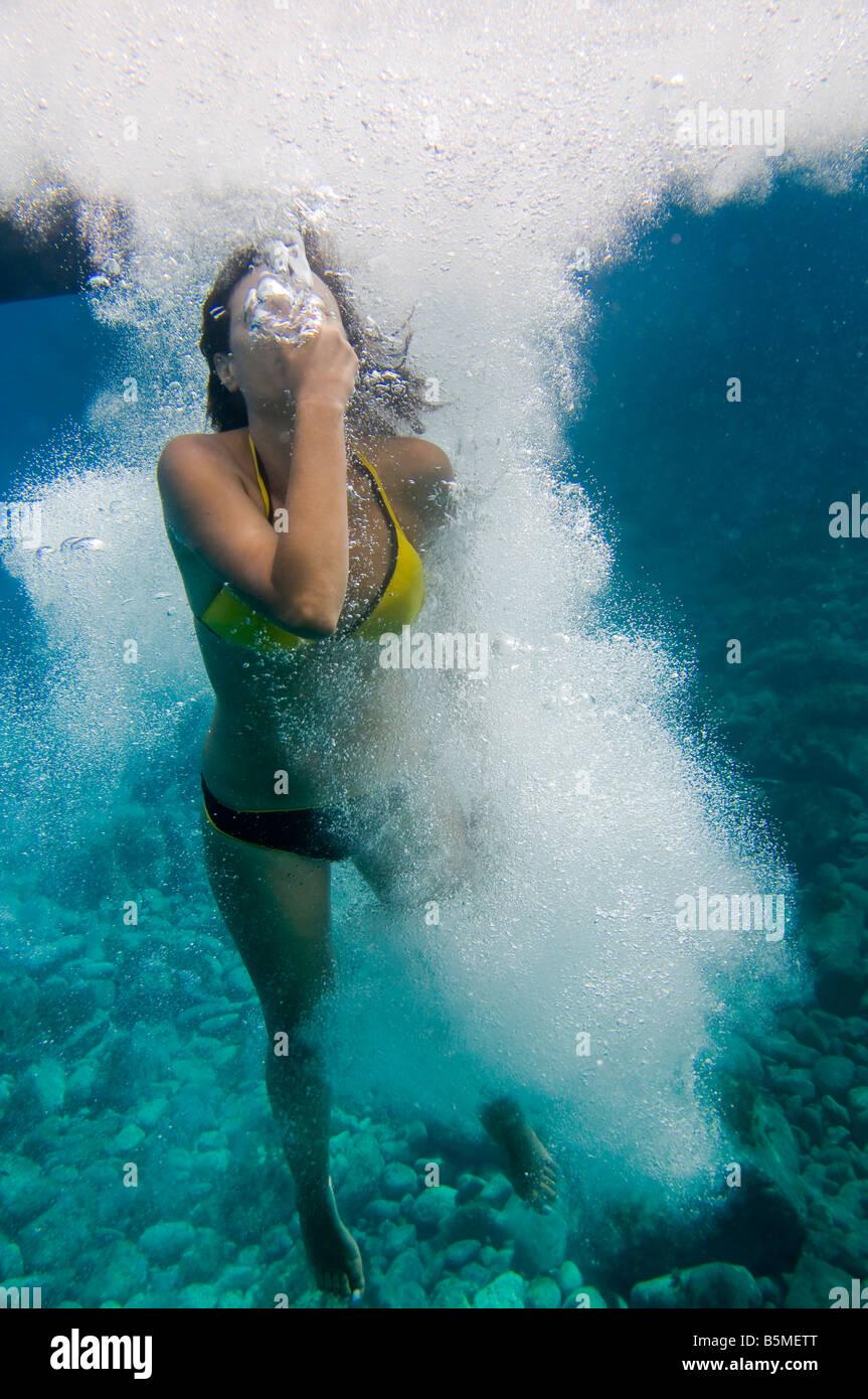 Woman diving underwater. - Stock Image