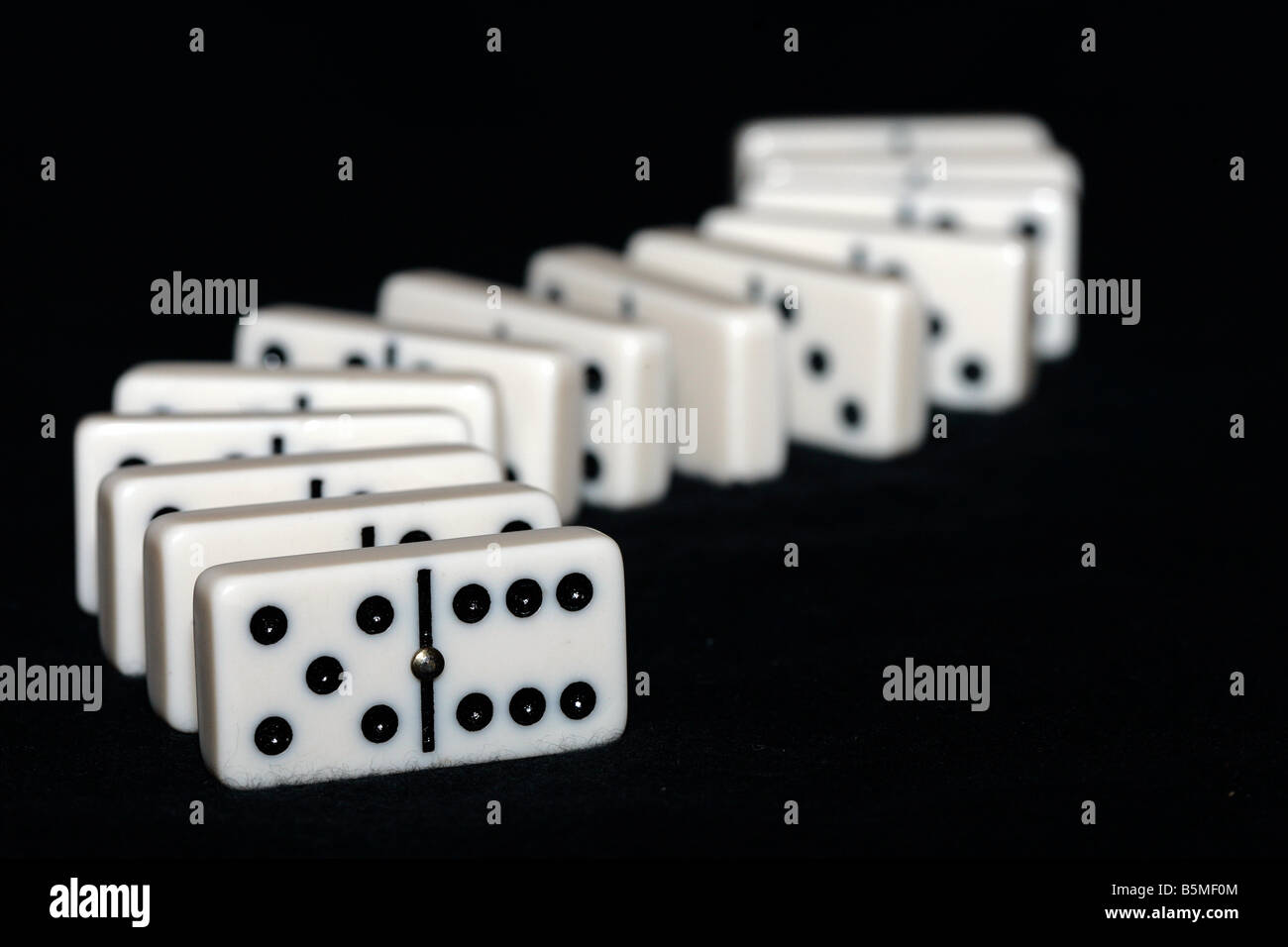Curved row of arrangened dominos Stock Photo