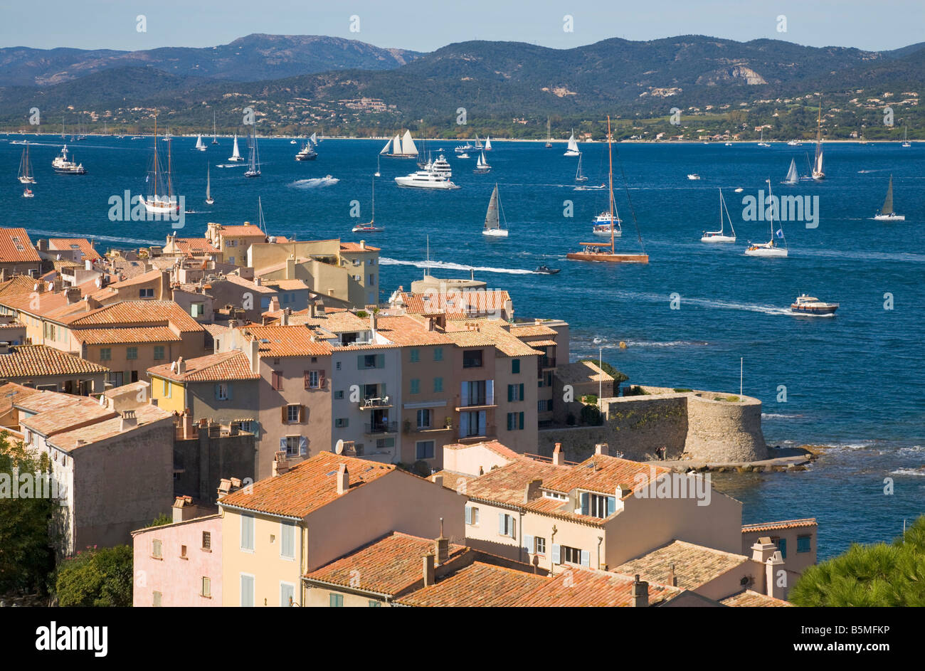 A view over the roofs of Saint Tropez / Cote d'Azur / Provence / Southern France down to the bay of Saint-Tropez Stock Photo