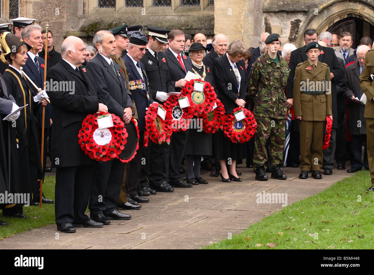Remembrance Sunday poppy day service parade local councillors and members of the Royal British Legion RAFA and Rotary - Stock Image