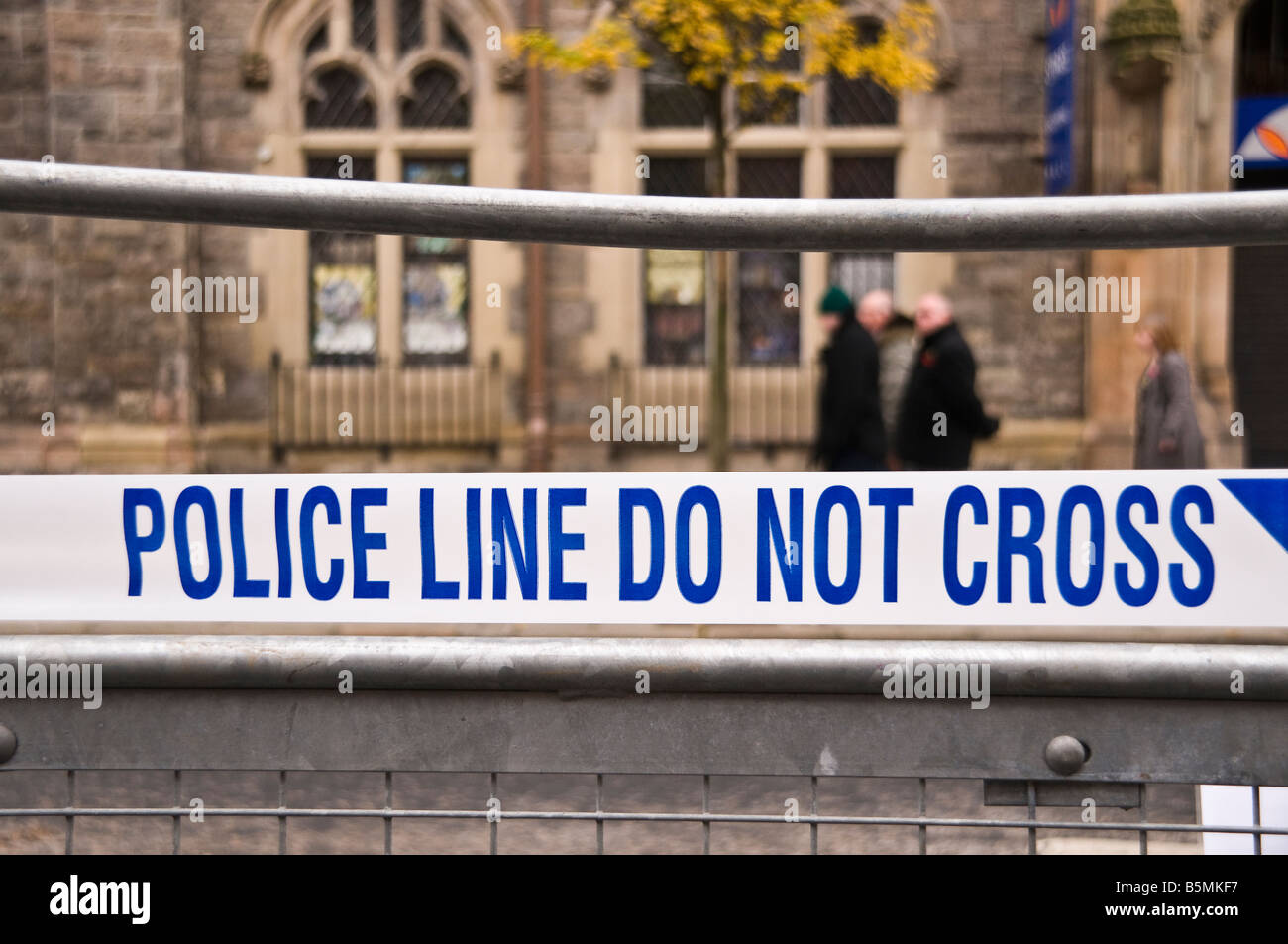 Police line do not cross tape blocking off a road following an incident Stock Photo