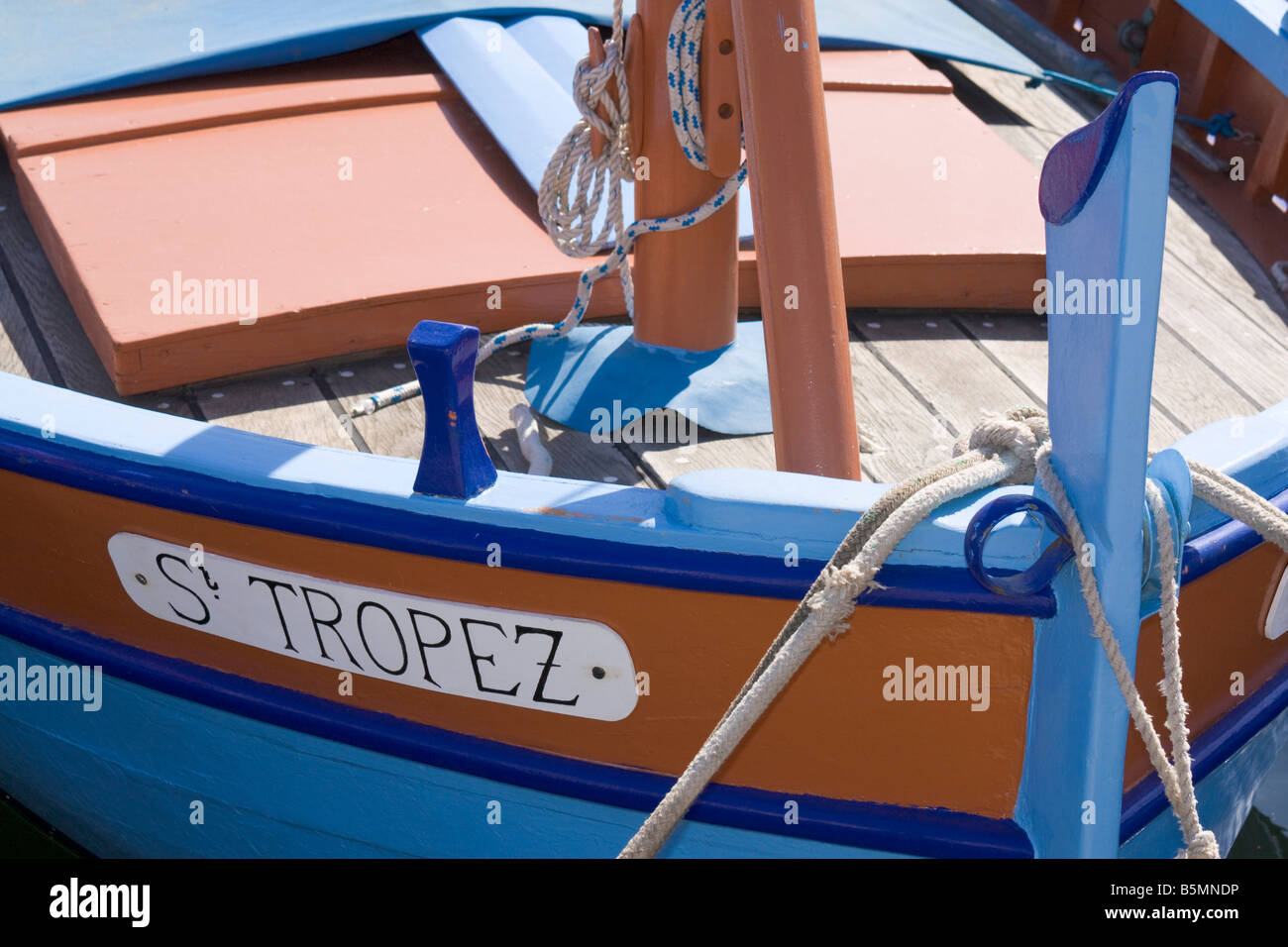 """A boat named """"St. Tropez"""" is situated in the port of Saint-Tropez at the Cote d'Azur / Provence / Southern France Stock Photo"""