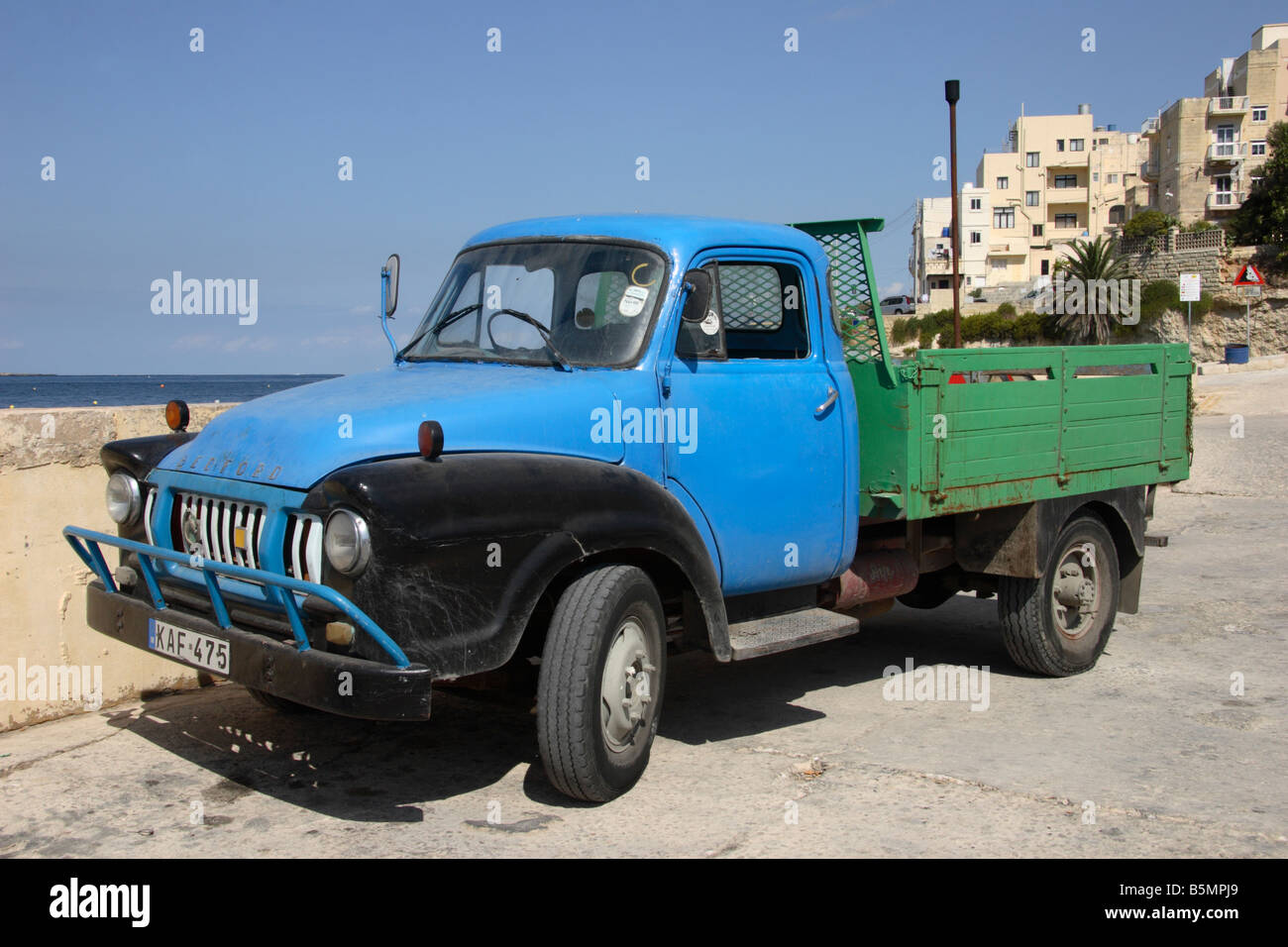 A vintage 'Bedford Truck' standing on the quayside at 'St Paul's Bay' in Malta. - Stock Image