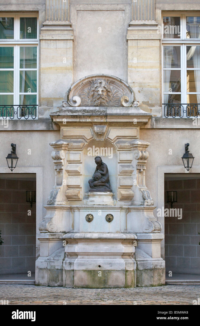 An old 17th Century Fountain at Hotel de Villacerf Rue de Turenne ...