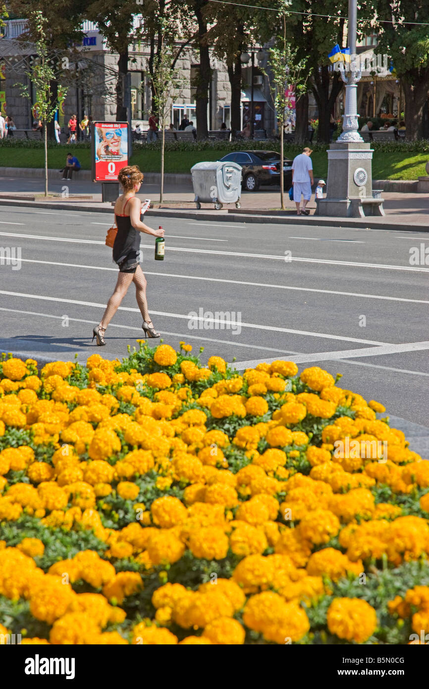 Woman walking across the main Khreshchatyk Street, near Independence Square, Kiev, Ukraine - Stock Image